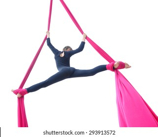 Outdoor activity of cheerful child training on aerial silks or ribbons. Isolated over white background. Childhood, sports, active lifestyle concept.