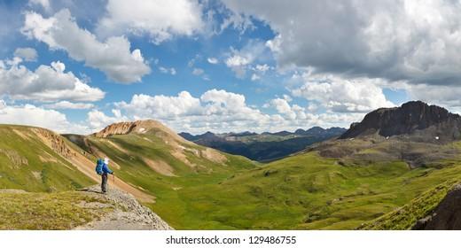 Outdoor Adventure Panorama. Hiker enjoys grand view of alpine tundra in Colorado, USA.