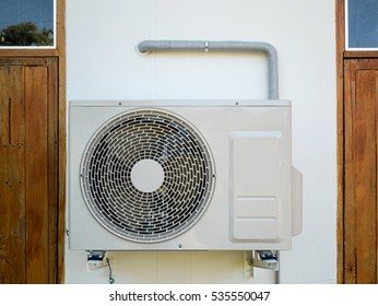 outdoor air conditioning unit on the wall