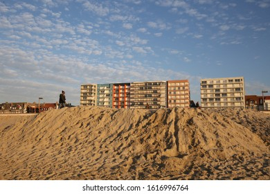 Outdoor alignment of apartment buildings located in front of the Atlantic sea, at le Touquet Paris Plage city, Pas-de-calais department, norther France. December, 31, 2019. Colored facades and sky,
