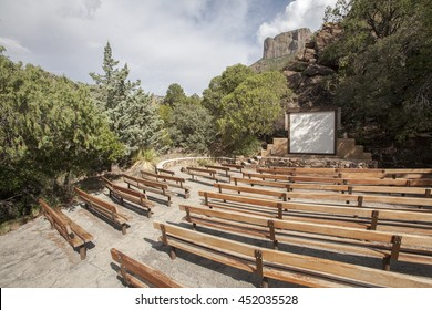 Outdoor amphitheater seating area with movie screen at Big Bend National Park, Texas.