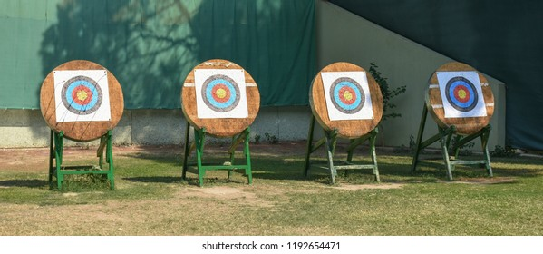 outdoor archery targets on grass field in summer day