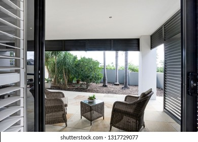 Outdoor area of a large porch and modern dining space
