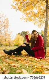 Outdoor atmospheric lifestyle photo of young beautiful lady. Brown hair and eyes. Warm autumn. Warm spring
