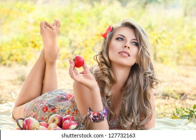 Outdoor autumn portrait of beautiful young woman