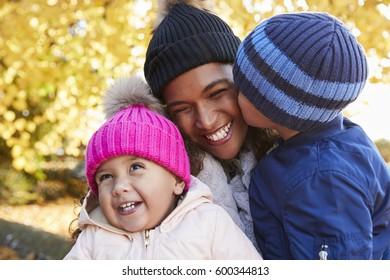 Outdoor Autumn Portrait Of Mother With Children