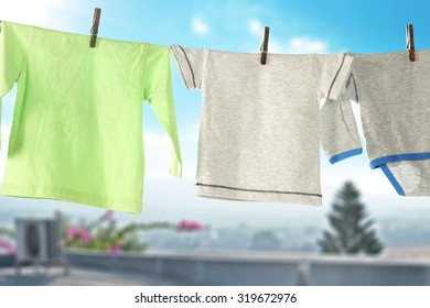 outdoor background of sky and closeup of baby clothes