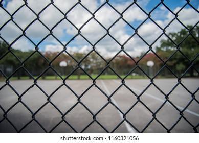 Outdoor basketball Court through Fence