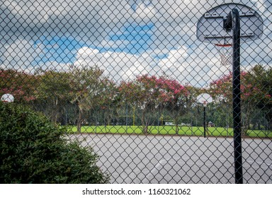 Outdoor basketball Court through Fence