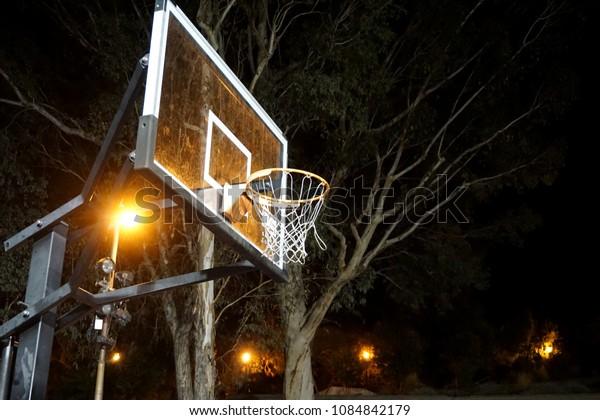outdoor basketball hoop at night