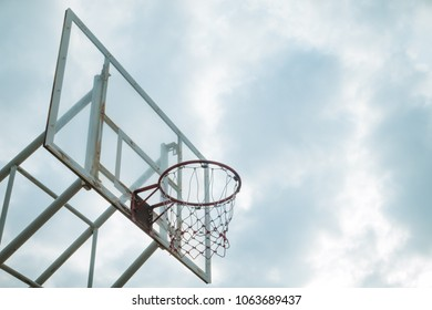outdoor basketball hoop under the sky in the morning