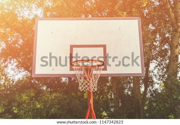 Outdoor basktetball hoop in a park. Basketball background.