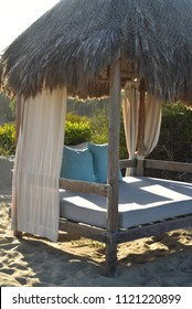 outdoor beach bed tropical luxury glamping relaxation