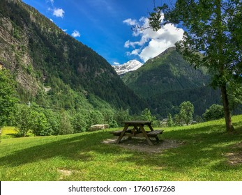 Outdoor Bench in Alpine Field