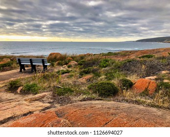 Outdoor bench on rocky coastal area at Cape Leeuwin during evening at Historic Water Wheel Cape Leeuwin, south-westerly of the Western Australia