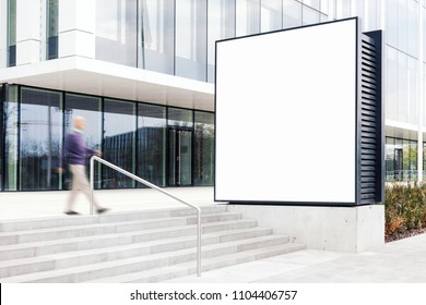 Outdoor billboard mockup with white copy space to add company names and logos in modern business district
