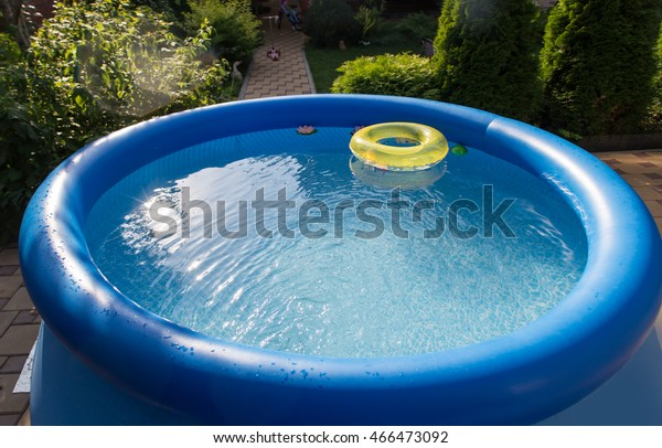 Outdoor blue inflatable pool with clean water