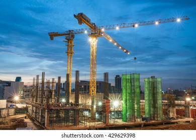 Outdoor buildings under construction with cranes.