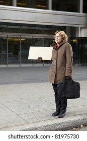 Outdoor business woman with blank sign vertical