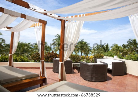 Outdoor cabana beds on a rooftop overlooking a tropical ocean. & Outdoor Cabana Beds On Rooftop Overlooking Stock Photo (Edit Now ...