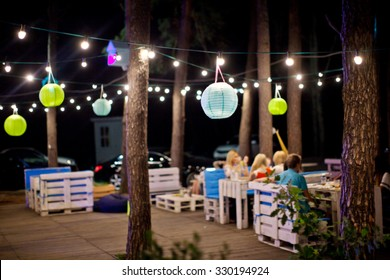 Outdoor cafe in the evening.