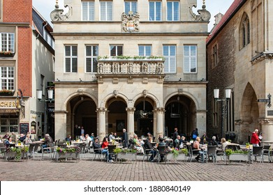 Outdoor Cafe in front of Gabled Houses in Prinzipalmarkt Street, Munster, Munsterland, North Rhine Westphalia, Germany in June 2016