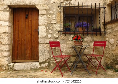 outdoor cafe table and chairs in medieval village of Gourdon, Provence, France