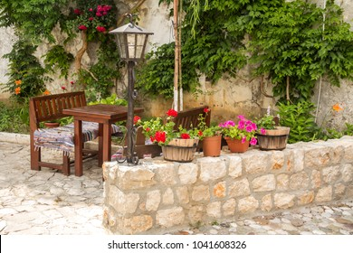 Outdoor cafe with table and old wooden chairs