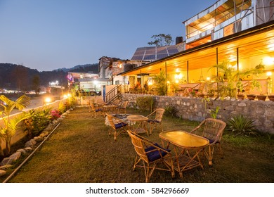 Outdoor cafe tables in the evening next to Phewa (Fewa) Lake in Pokhara, Nepal