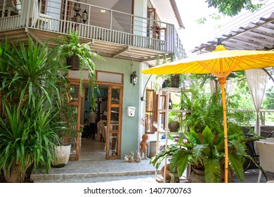 outdoor cafe with umbrellas outside stool tables for the customer to sit and order food or coffeee