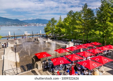 Outdoor cafe and water park overlooking Vancouver Harbour near the Convention Centre, Vancouver, British Columbia, Canada, North America 12 September 2017