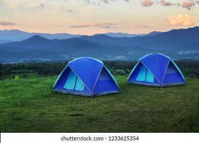 Outdoor camping tent among meadow on mountain during sunset at Yun Lai Viewpoint, Pai town , Mae Hong Son in Thailand. This is very popular for photographers and tourists.Travel and natural Concept