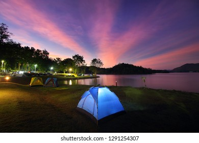 Outdoor camping tent during twilight time with colorful sky at Kaeng Krachan National Park, Phetchaburi in Thailand. Travel and natural Concept.