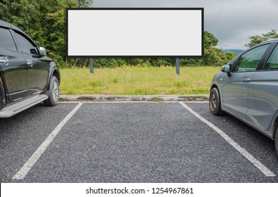 outdoor car parking and empty white billboard .Blank space for text and images.