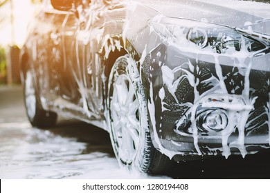 Outdoor car wash with foam soap.