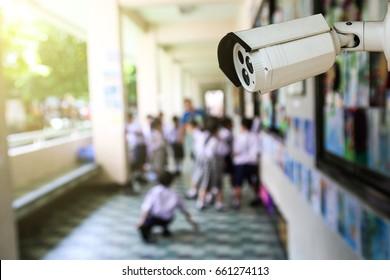 Outdoor CCTV monitoring at a school corridor, security cameras.