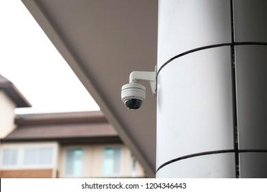 Outdoor CCTV monitoring, security cameras at school building.