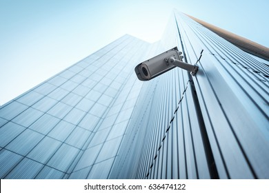 Outdoor CCTV Security camera installed on the building wall in the city