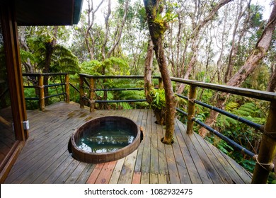 Outdoor cedar hot tub at a treehouse in the rainforest near Hilo and Volcano on the Big Island of Hawaii.