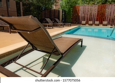 Outdoor Chaise Lounger next to the pool.