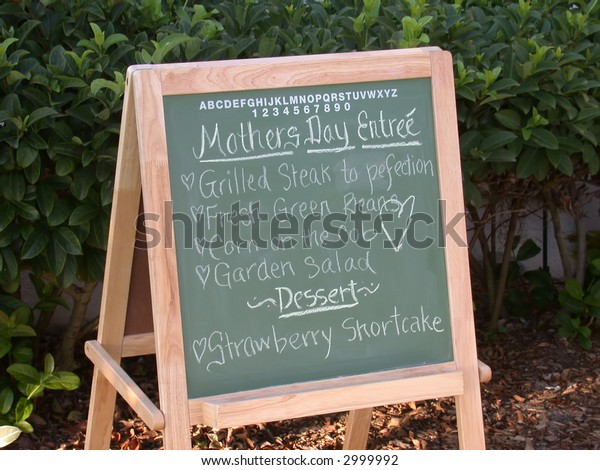 An outdoor Chalkboard menu featuring a Mother's Day meal