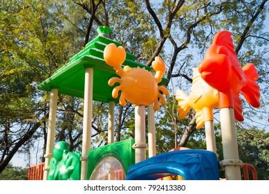 Outdoor children playground in green nature city park