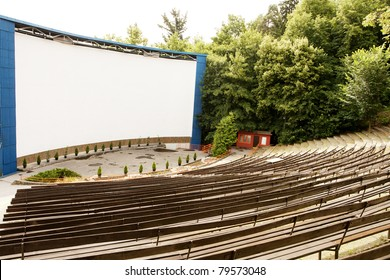 Outdoor cinema stage and empty seats