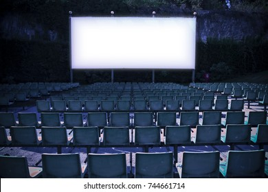 Outdoor cinema with white projection screen - toned image