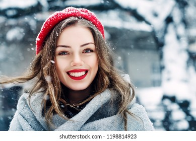 5c4a3d05 Outdoor close up portrait of young beautiful happy smiling girl with red  lips, wearing french