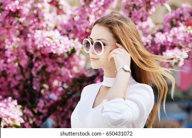 148407519b0 Outdoor close up portrait of young beautiful fashionable girl posing in  street