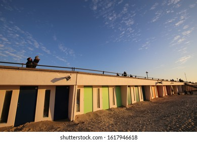 Outdoor close up view of a row of beach painted cabins in le touquet paris plage city, pas-de-calais department, hauts de France region, France. December, 31, 2019. Alignment of colorful wooden doors.