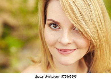 outdoor closeup portrait of a beautiful blonde woman