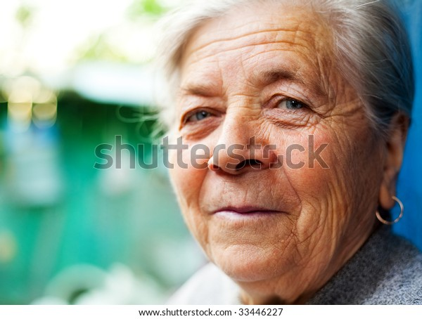 Outdoor Closeup Portrait of Smiling Old Senior Lady