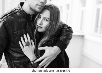 Outdoor closeup portrait of young sensual couple in love posing on the street in spring